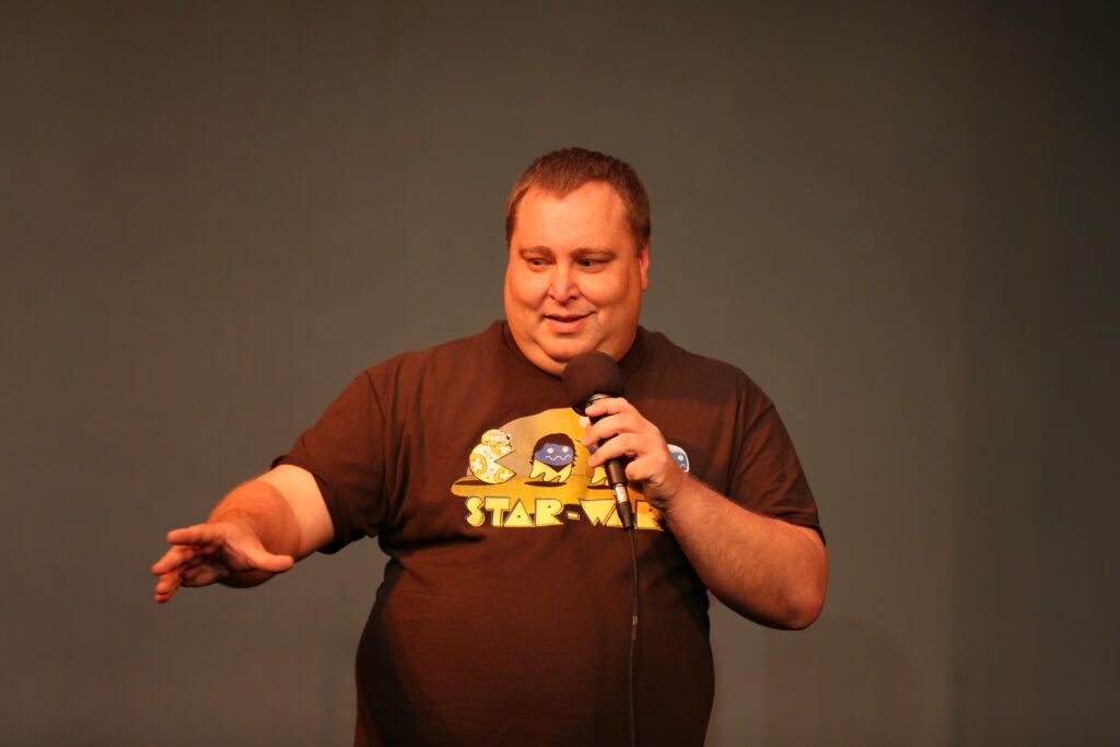 Chris Hammell performing at National Comedy Theatre